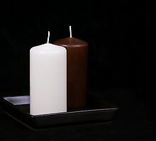 White and Brown Candles by Tom Klausz