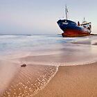 Wrecked ship ashored in Sharjah - Ajman beach on the cost of Persian Gulf by naufalmq