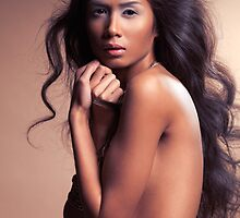 Sensual portrait of a beautiful young woman with long wavy hair art photo print by ArtNudePhotos