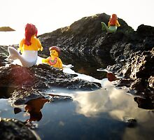 Mermaids on the rocks by bricksailboat
