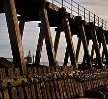 Lighthouse view through the Wooden Pier by Violaman