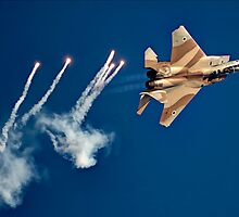 IAF Fighter jet F-15I (Raam) in flight Emitting anti-missile flares by PhotoStock-Isra