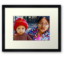 Boy and his mother in Bagan, Myanmar Framed Print
