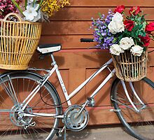 White Bicycle with Basket of Flowers by SunshineL