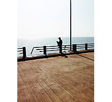 Lonely Man Sitting On Railing By The Ocean Photographic Print