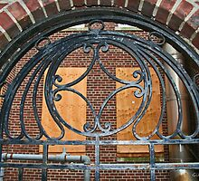 Weathered Ornate Iron Gateway by Gilda Axelrod