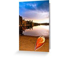 Lake sunset with canoe on beach Greeting Card