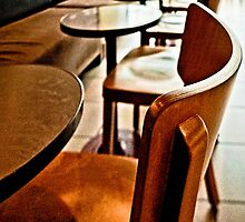 Empty chairs at empty tables by Beverley Goodwin