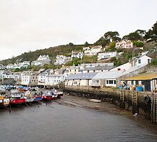 Low tide at Polperro fishing village by photoeverywhere