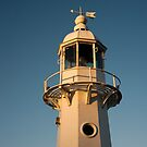 Mevagissey Lighthouse in the Evening by Anne Gilbert