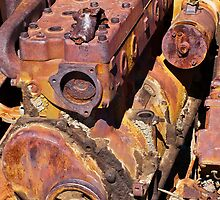 engine block rusting away in the desert by David Chesluk
