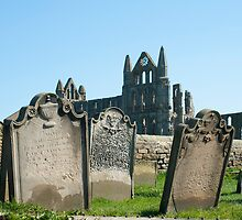 Gravestones at Whitby abbey by photoeverywhere