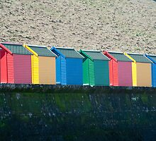 Colourful beach huts and Whitby sands by photoeverywhere