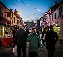 Arm in arm at the Mistletoe fayre by Sue Knight