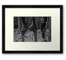 on stilts Framed Print