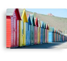 Row of colourful Beach huts Canvas Print