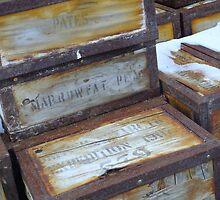 Crates stacked up alongside Shackleton's hut by Karen Stackpole