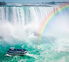 Rainbow and tourist boat at Niagara Falls by Elena Elisseeva