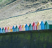 Colorful Beach huts and Whitby sands by photoeverywhere
