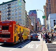 Tour Bus in Manhattan, New York by Zal Lazkowicz