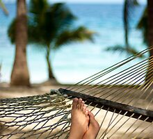Man relaxing in a hammock by photoeverywhere