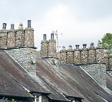 Roofs and chimney pots on Cumbrian cottages by photoeverywhere