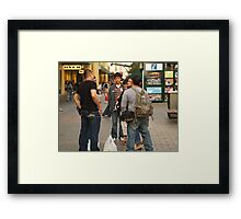 Chatting in the mall Framed Print