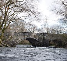 Skelwith Bridge with the river in spate by photoeverywhere