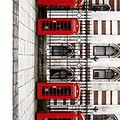Four traditional red phone boxes in a row, London, England by Vincent Abbey