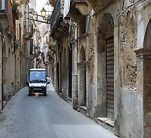 Police patrol in the streets of Siracusa by Arie Koene