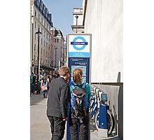 Visitors look at a West End cycle hire map Photographic Print