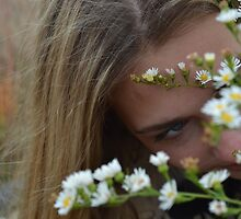 hiding behind the flowers. by jilleeean