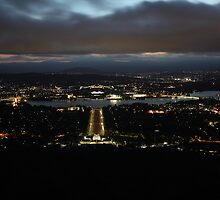 Night shot of War Memorial to Old and New Parliament House, Canberra, Australia by Leisa Stear