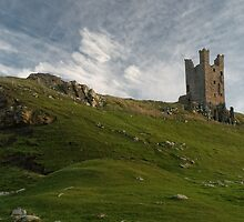 Dunstanburgh castle and hill by StephenRB