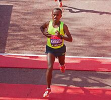 Kebede crosses the finish line of the London Marathon  by Keith Larby