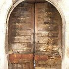 Old wooden door in the medieval town of Mercogliano, Province of Avellino, Campania, Italy by Rachel Veser
