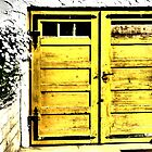 Old wooden garage door by ©The Creative  Minds