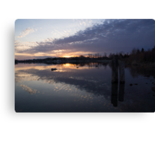 Sunset Sentinels - Three Pillars Guarding the Sundown Reflections Canvas Print