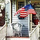 Porch With Flag and Wicker Chair by Susan Savad