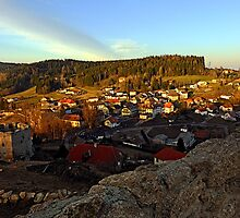 Village skyline below the castle at sundown | landscape photography by Patrick Jobst