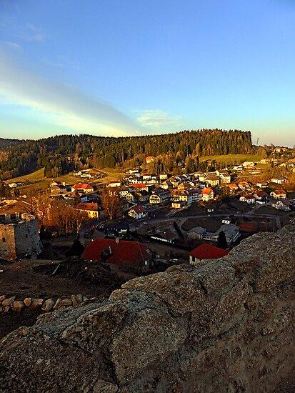 Village skyline below the castle at sundown   landscape photography by Patrick Jobst