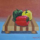 Peppers on a board by John Marcum