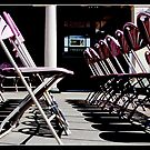 Empty Chairs in the Bandstand by John Thurgood