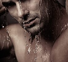 Dramatic portrait of young man under a shower art photo print by ArtNudePhotos