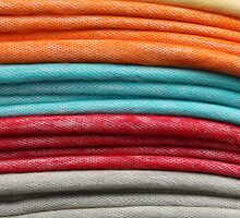 Stacked Colorful Blankets at the Market by rhamm