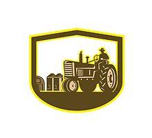 Farmer Driving Tractor Plowing Farm Shield Retro by patrimonio