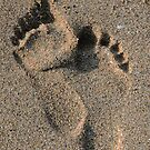 Footprints in the sand by Roxy J