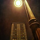 Night with street lamp and building by Silvia Ganora