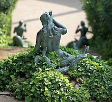 Statue  mermaid in the bush by mrivserg