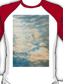 Blue sky reflections in a lake  T-Shirt